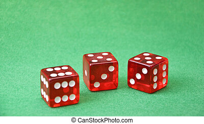 Row of dice on green background