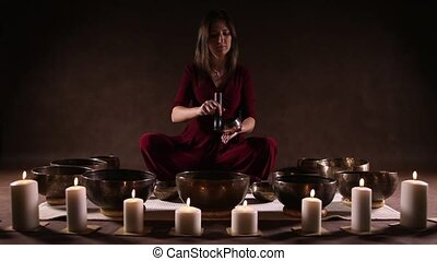 The sound of Tibetan singing bowl - Woman playing small...