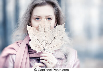 Young woman with maple leaf