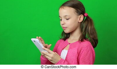Emotional little girl talking on a smartphone - Emotional...