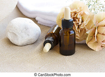 A dropper bottle of essential oil on a beige sackcloth