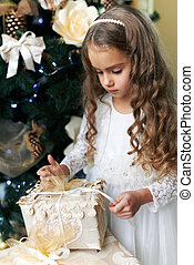Beautiful girl opens gift for the new year - Beautiful girl...
