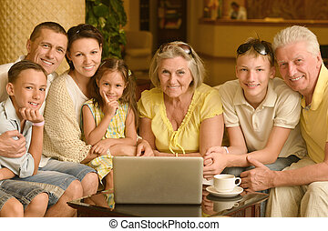 family sitting with laptop - Portrait of a happy family...
