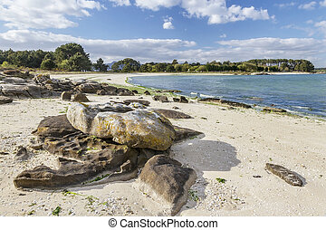 Rocks on Salinas beach in Carreiron natural park, Arousa...