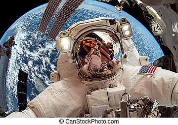 International Space Station and astronaut - International...