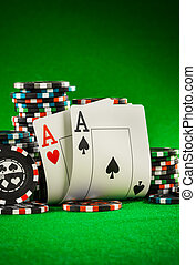 chips and two aces - Stack of chips and two aces on the...