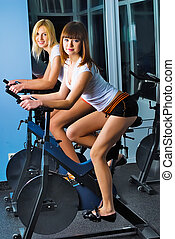 Attractive girls on bicycle simulators