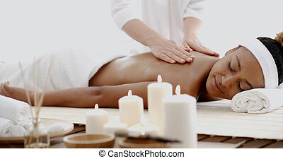 Young Woman Having A Massage In Spa