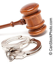 Gavel and Handcuffs on White - Gavel and Handcuffs Isolated...