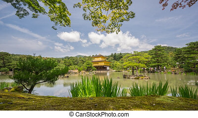 Buddhist Kinkaku-ji (Golden Pavilion) temple time lapse -...