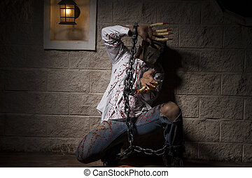 expression, halloween monster chained with bloody hook,...