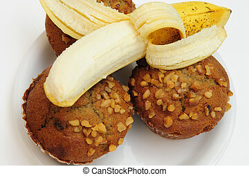 Banana And Muffins - Closeup of three banana nut muffins...