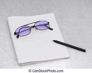 Purple tinted glasses with notebook and pen, for writing....