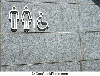Restroom symbol on mable wall