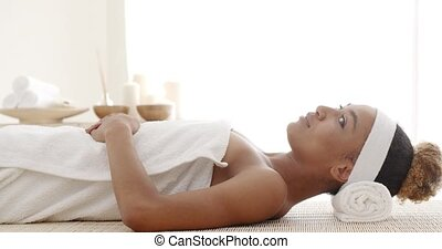 Smiling Female Enjoying Spa Therapy - Attractive african...
