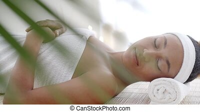 Woman Lying On A Lounger In Wellness Center - Close up of a...