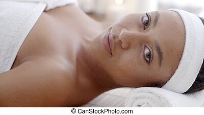 Woman Relaxing Health Spa - Young woman relaxing and lying...