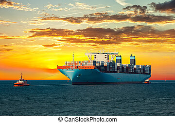 Container ship on sea - Tugboats assisting container ship on...