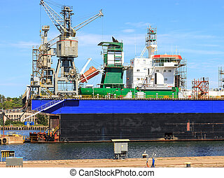 Ship In Dry Dock - A big ship on the dry dock in a shipyard...