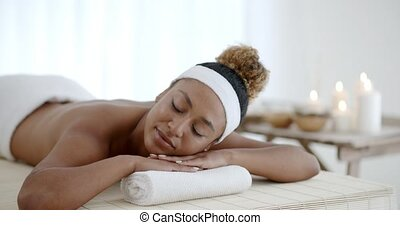 Happy Girl Relaxing In Spa Salon - Happy african american...