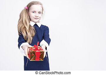 Portrait of cute Caucasian Blond Kid with Gift Against White...