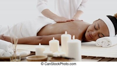 Young Woman Having A Massage In Spa - Masseur doing massage...