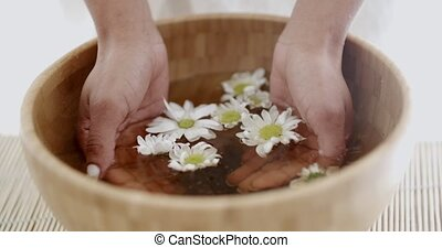 Female Hands With Bowl Of Aroma Water - Close up of a female...