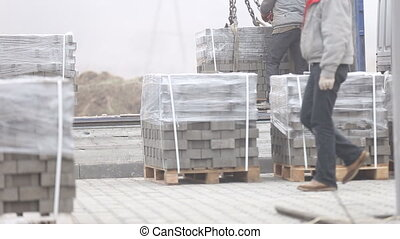 unloading of paving slabs close up
