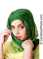 Face with green eyes and scarf - Portrait of shy mysterious...