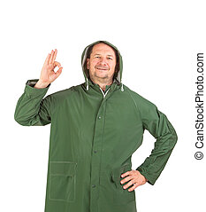 Man in rain green long coat Isolated on a white background