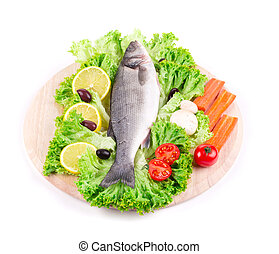 Fresh seabass with tomato on plate. Isolated on a white...