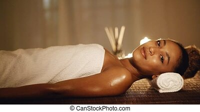 Girl In A Towel Lies On Massage Table - Girl in a towel lies...
