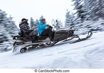 Snowmobile on winter forest road - Snowmobile on a winter...