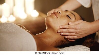 Young Woman Enjoying Facial At Spa Salon - Relaxing woman...
