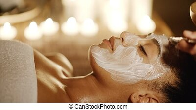 Cosmetic Mask On The Face - Cosmetologist smears cosmetic...