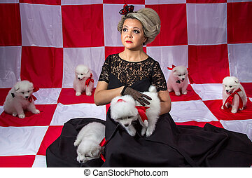 Blond woman in crown with little puppies on plaid background