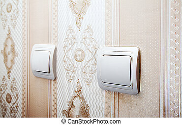 two switches on the wall