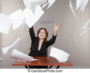 business woman throwing up documents - young smiling...