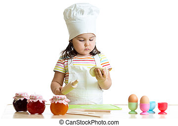 Child little chef with flour stretching the dough isolated