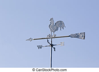 Rooster weather vane - White rooster weather vane on the...
