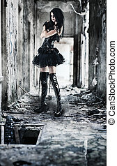 Young goth woman in ruined building Contrast colors