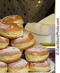 Stack of italian doughnuts with icing sugar