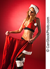 Young sexy woman in santa clothing with big pants