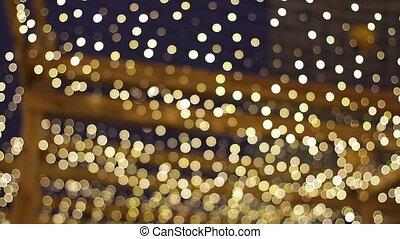 A lot of garlands. - Christmas garlands. Blurring...