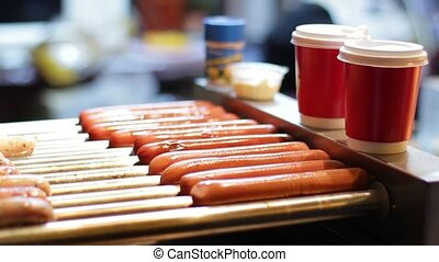 Sausages for hot dogs. - Cooking sausages. Sausages for hot...
