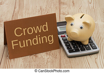 Crowd Funding, A golden piggy bank, card and calculator on wood background