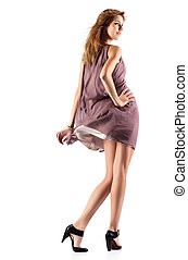 Young slim woman in fluttering dress. Isolated on white.
