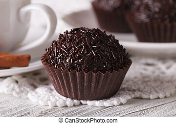 Brazilian chocolate candy Brigadeiro macro. horizontal -...