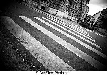 Crosswalk in a city. Black and white.