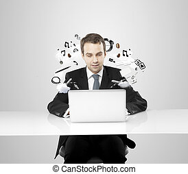 businessman working on notebook with flying around things